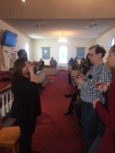 Interpreter/SSP sign music to deafblind people