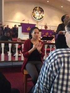 Interpreter/SSP sign to deafblind person during church