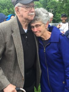 Visual Description: Ray Dix and Peggy Johnson hug each other